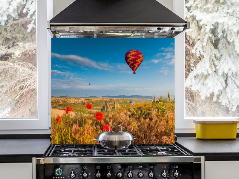 Hot Air Balloon Flying Over Red Poppies Hob Splashback